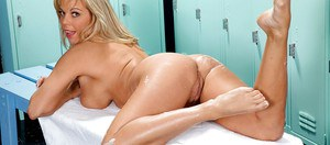 Older lady Amber Lynn Bach rubbing lotion into sexy legs in change room