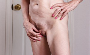 Skinny granny Bossy Ryder takes off her panties to show off her starving holes