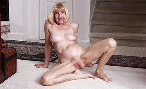 Blonde grandmother Bossy Ryder tugging on labia lips after getting naked