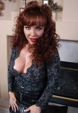 Mature dame Vanessa flashing fake tits before inserting dildo into naked pussy