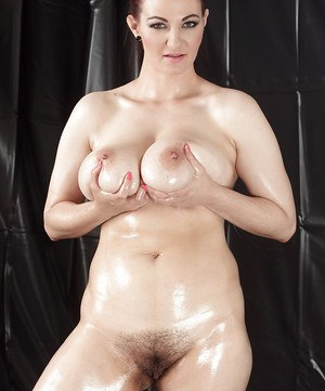 Oiled up fatty Vanessa squeezes her massive tits and masturbates hairy pussy