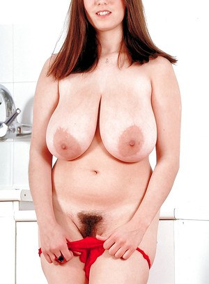 Redhead seductress with big tits Nicole Peters plays a solo licking her boobs