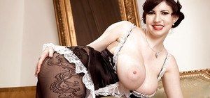 Elegant maid with big tits Karina Hart takes off her uniform to pose naked