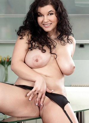 Chubby brunette Lola Hot displaying big natural tits while parting labia lips