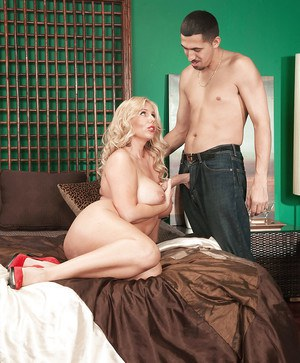 Chunky blonde mom Karen Fisher riding cock inbed waering red pumps