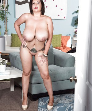 Dark haired MILF Paige Turner revealing massive tits while stripping naked