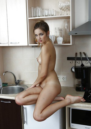 Teen first timer Linda Blink displaying hairless pussy on kitchen counter top