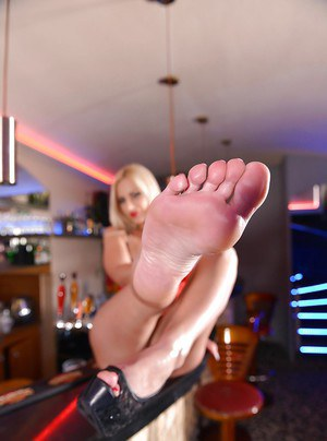 Hot blonde chick Nathaly Cherie spreading toes before toying shaved pussy