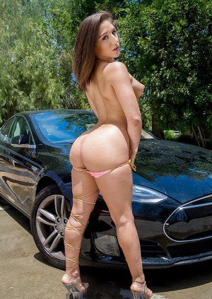 Teen pornstar Abella Danger releasing pointy tits and booty from bikini on car