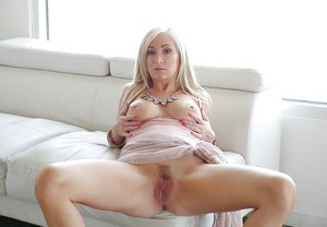 Sexy blonde MILF Hillary Scott exhibiting pink twat with dress hiked up