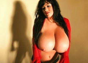 Dark haired Euro model Rachel Aldana demonstrating massive all natural boobs