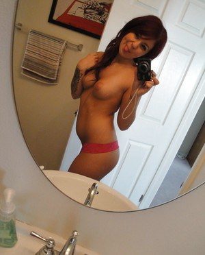 Young redhead cutie Madelyn Manroe taking naked selfies in mirror