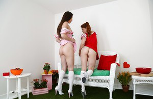 Lesbians Penny Pax and Casey Calvert covering bare butts with lotion