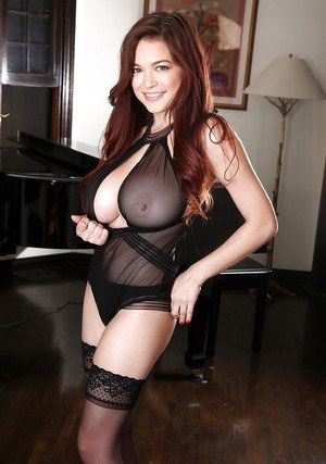 Redhead pornstar Tessa Fowler letting large breasts loose from sheer lingerie