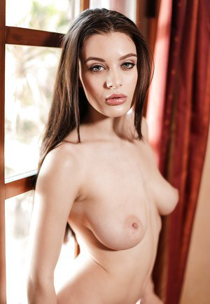 Lana Rhoades shakes the boobs while posing nude in romantic scenes