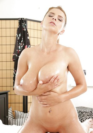 Busty Katerina uses the juggs to stroke cock while enjoying blowjob as well