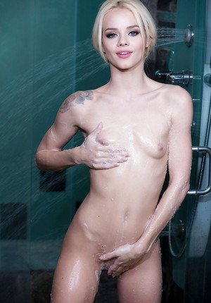 Petite blond pornstar Elsa Jean running water over naked body after undressing