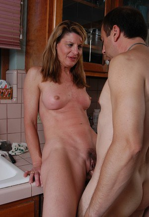 Naked mature woman Linda home porn along man with fat cock