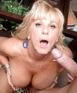 Chubby older blonde Zena Rey giving younger guy a BJ after seducing him