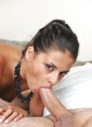 Sultry brunette Coco de Mal spitting out jizz from mouth after giving blowjob