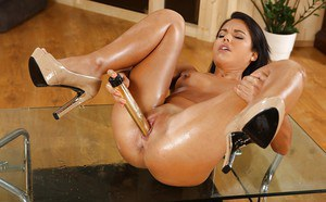 Apolonia sucks the toy before letting it lose into her creamy vagina