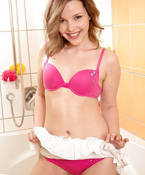 Missie removes the pink lingerie for a complete shower XXX solo play