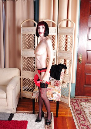 Older dame Alyce Porter demonstrating wide open pussy in black stockings