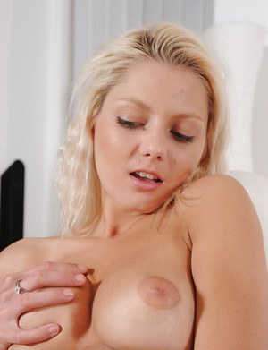 Sweet blonde female Ingrid plunging fingers into hairless pussy
