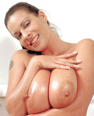 European big tit model Linsey Dawn McKenzie covering hooters with lotion