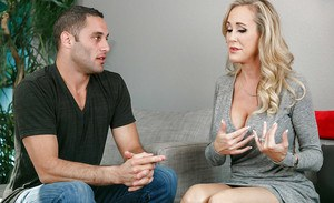 Blonde MILF Brandi Love getting naked while sucking off large penis