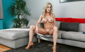 Blonde mom Brandi Love revealing large tits and nice ass while undressing