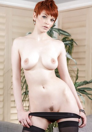Redhead solo girl Bree Daniels removing bra and panties to model in stockings