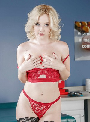 Sexy blonde chick Samantha Rone stripping down to stockings on exam table