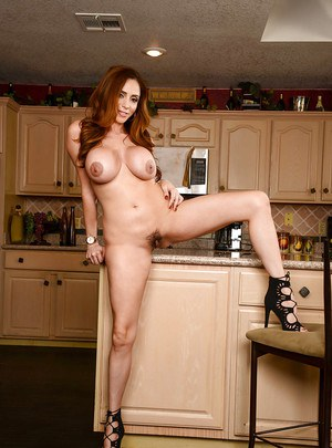Sexy Latina MILF Ariella Ferrera baring hooters while disrobing in kitchen