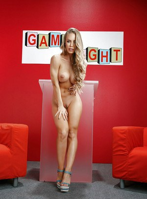 Blonde pornstar Nicole Aniston stripping naked on sofa during game show