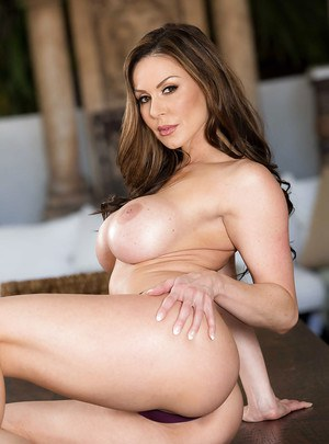 MILF pornstar Kendra Lust revealing round tits and sexy ass in kitchen