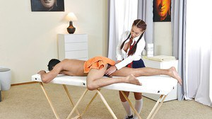 Clothed European masseuse Jenny jerking and milking client's cock