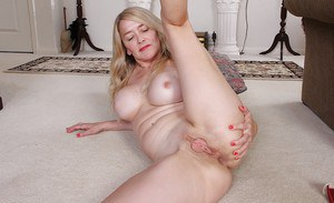 Mature solo model Eva Griffin unveiling big tits and folded back labia lips