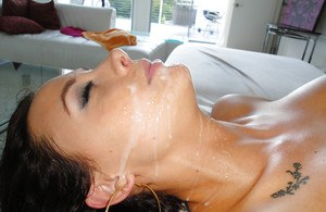 Pretty brunette chick gets her big tits squeezed and face covered with jizz