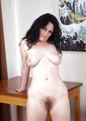 Mature woman Andrea Foster peeling off yoga clothes to reveal hairy muff