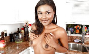 Ebony first timer Yara Skye freeing tiny tits and smooth pussy in kitchen