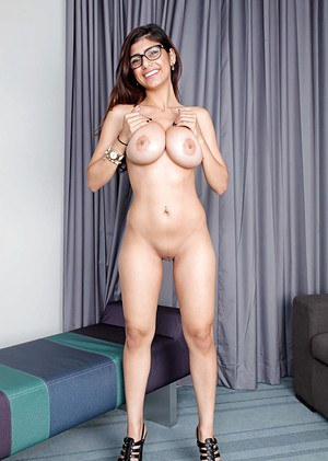 Exotic pornstar Mia Khalifa unveiling nice melons and shaved pussy