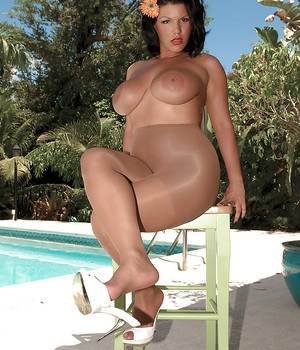 Chunky Latina housewife Angelina Castro posing by pool in crotchless pantyhose