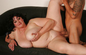 Obese brunette Andrea E giving oral sex before getting fucked on sofa