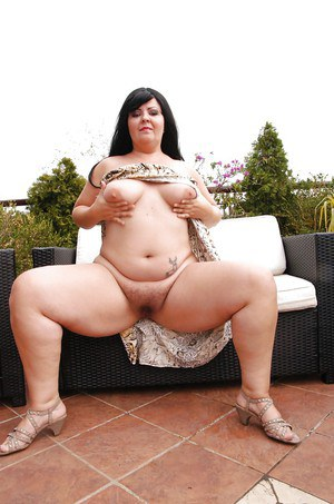 Obese brunette mom Carmen Carlos revealing hairy twat and big ass on patio