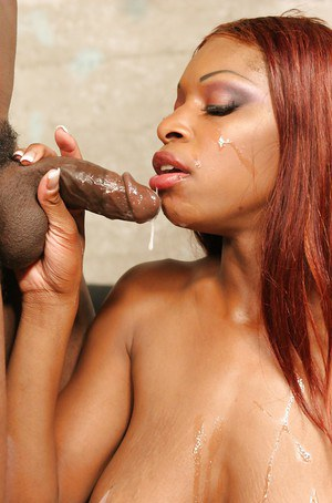 Redheaded black chick Alana Play riding black cock after oral sex