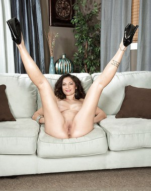 Leggy lady Jessica Torres delving fingers into pussy after disrobing