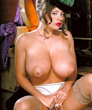 Naughty MILF Linsey Dawn McKenzie unveiling hooters and trimmed muff