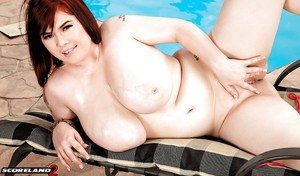 BBW solo model Roxanne Miller baring hooters before finger fuck by pool