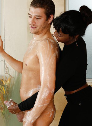 Clothed black girl Ana Foxxx giving naked man reach around handjob in bathroom
